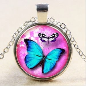 Necklace- NEW- Blue Butterfly Pink Background
